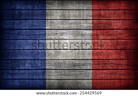 France flag pattern on wooden board texture ,retro vintage style - stock photo