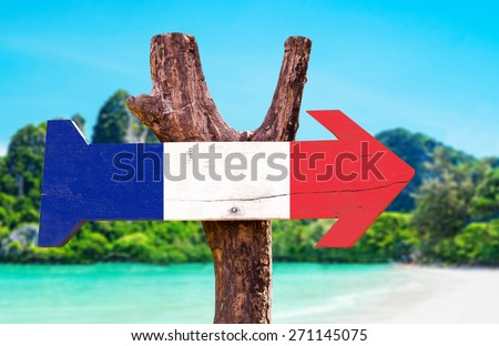 France Flag wooden sign with beach background - stock photo