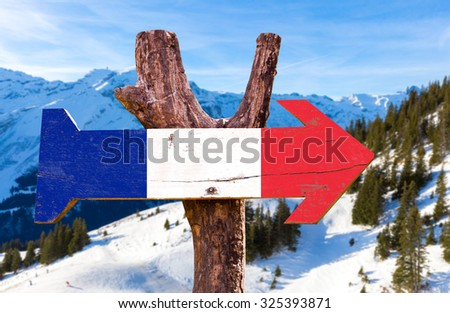 France Flag wooden sign with winter background - stock photo