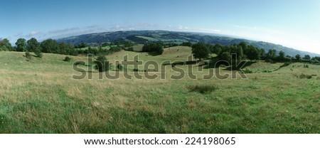 France, grassy hills, panoramic view - stock photo