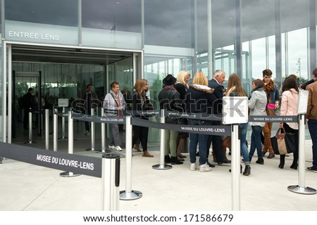 FRANCE, LENS - SEPTEMBER 19, 2013: Visitors wait in the entrance of the Louvre-Lens. This art museum, located in Lens, Pas-de-Calais, Northern France, was inaugurated on December 4, 2012 - stock photo