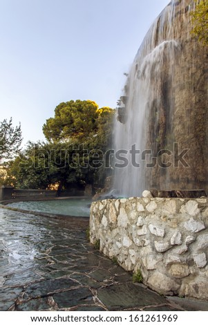 France , Nice. Artificial waterfall on the hill Chateau - stock photo