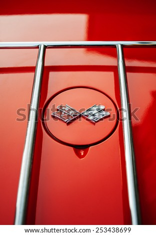FRANCE, PARIS - FEB 10, 2013: Trunk ornament of racing flags on a 1962 Corvette automobile. Corvette is a sports car manufactured by the Chevrolet division of American automotive General Motors (GM) - stock photo