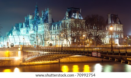 France - Paris  Hotel de ville and Seine river at night - stock photo
