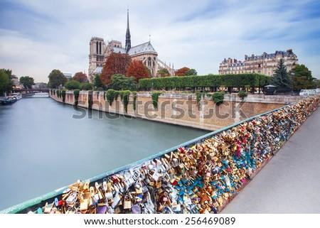 France, Paris - Nov 25: Locks on bridge near Notre Dame de Paris, France - stock photo