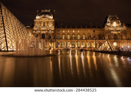 France, Paris - Nov 25: The Louvre Pyramid on November 25, 2013 in Paris, France. It serves as the main entrance to the Louvre Museum. Completed in 1989 it has become a landmark of Paris. - stock photo
