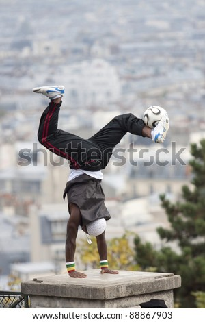 FRANCE, PARIS - NOVEMBER 4: Iya Traore - a professional soccer player makes a soccer freestyle demonstration in front of Basilica Sacre Coeur. November 4, 2011 in Paris, France.