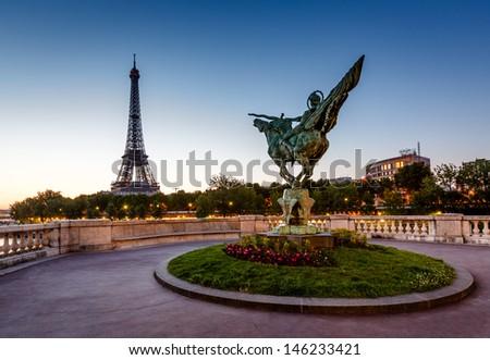France Reborn Statue on Bir-Hakeim Bridge and Eiffel Tower at Dawn, Paris, France - stock photo