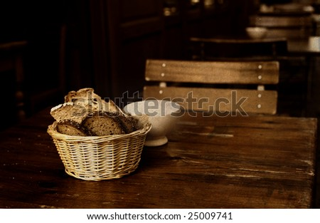 France. Restaurant table with crusty french bread in a basket and white sugar - stock photo