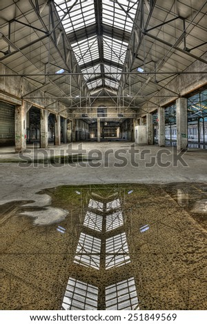 FRANCE - SEPTEMBER 18: Abandoned old industrial building with reflection in a puddle on September 18, 2011 somewhere in France