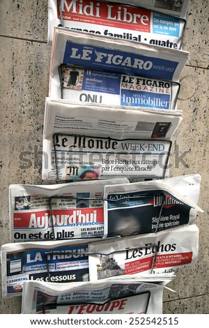 FRANCE - SEPTEMBER 24, 2011: Retail sale of french newspapers - stock photo