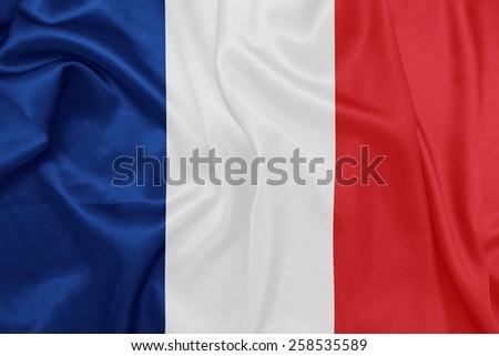 France - Waving national flag on silk texture - stock photo