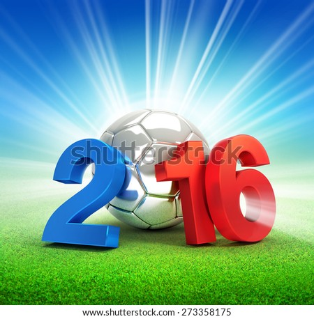 France 2016, year illustrated with a silver soccer ball, illuminated on a grass field - stock photo