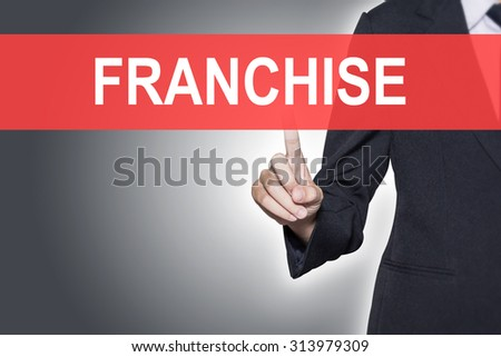 FRANCHISE Business woman pressing hand word on virtual screen - stock photo