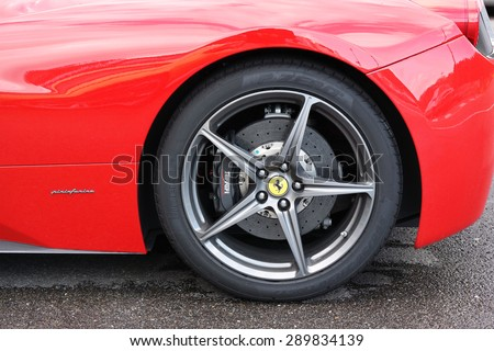 FRANCORCHAMPS, BELGIUM - MAY 6: Close-up of a wheel with carbon ceramics brake of a Ferrari sportscar designed by Pininfarina. Taken at May 6, 2015 at the Spa-Francorchamps circuit, Belgium - stock photo
