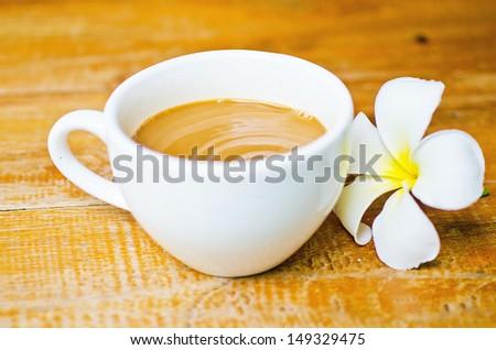 Frangipani  and coffee - stock photo