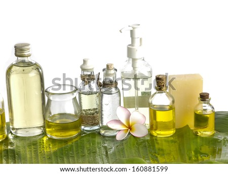 frangipani and massage oil with soap on wet banana leaf  - stock photo