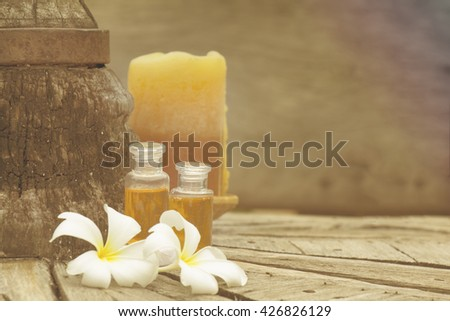 Frangipani, oil and Candle. Spa concept with warm tone - stock photo