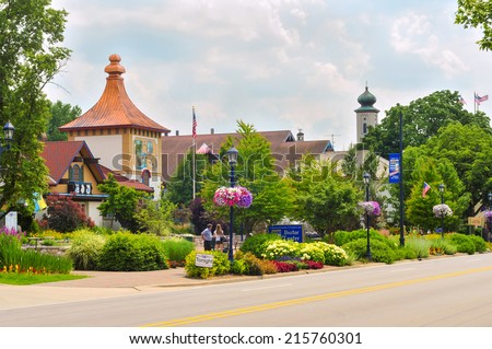 FRANKENMUTH, MI - JUNE 28, 2014: Bavarian-style architecture is one of the main attractions in this Michigan town known best for Christmas and German food. In view: the visitor center on Main Street. - stock photo