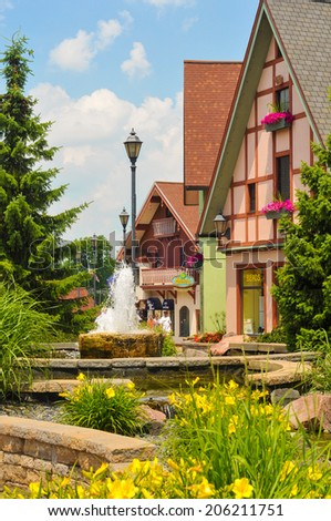 FRANKENMUTH, MI - JUNE 28, 2014: German-style architecture forms the backdrop of River Place, a new collection of shops and attractions in this tourist haven, settled in 1845 by Lutheran immigrants. - stock photo