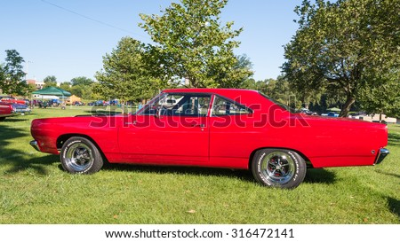 FRANKENMUTH, MI/USA - SEPTEMBER 13, 2015: A 1968 Plymouth Road Runner car at the Frankenmuth Auto Fest, held in Heritage Park. - stock photo
