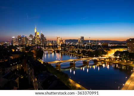 Frankfurt am Main at night, Germany - July 3, 2014: Skyscrapers of Frankfurt am Main. Frankfurt am Main is a international financial and trade city with the most imposing skyline in Germany.