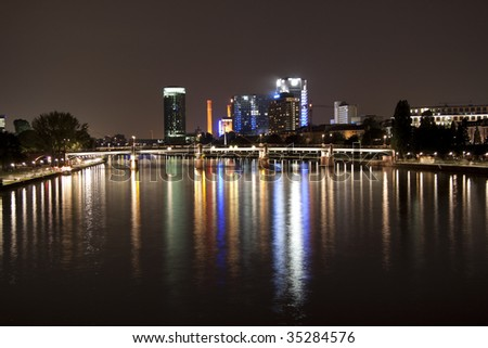 Frankfurt am Main by night from the old bridge - stock photo