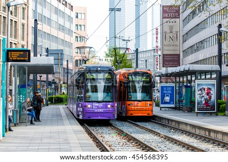 FRANKFURT AM MAIN, GERMANY - APRIL 30, 2016: An electric tram passing by the Downtown Hall an the Baseler platz square.