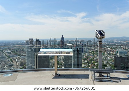 FRANKFURT AM MAIN, GERMANY - AUGUST 6, 2015: Aerial view of the central business district from the observatory deck of the Main tower. Frankfurt is the largest financial center in continental Europe. - stock photo