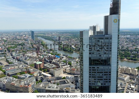 FRANKFURT AM MAIN, GERMANY - AUGUST 6, 2015: Aerial view of the Commerzbank tower from the Main tower. It is the tallest building in Frankfurt and in Germany and the second tallest in the EU. - stock photo