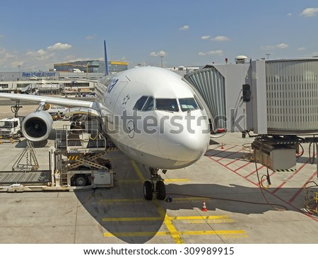 FRANKFURT AM MAIN, GERMANY - JULY 16, 2015: Passenger airplane front view in Frankfurt am Main. With 38 million passengers per year it is one of the most important airport in Europe.