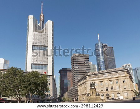 FRANKFURT AM MAIN, GERMANY - JULY 2, 2015: The Commerzbank tower and The Main Tower skyscraper in the city of Frankfurt Main. - stock photo