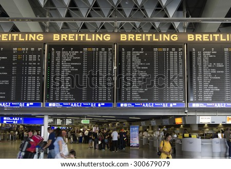 FRANKFURT AM MAIN, GERMANY - JULY 2, 2015: Travelers at public area at international Frankfurt Airport, the busiest airport in Germany. Longer exposure. - stock photo