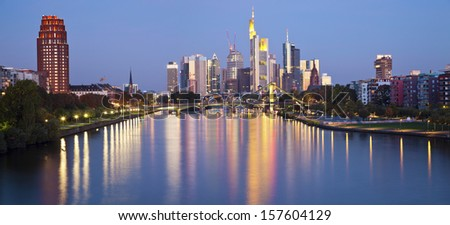 Frankfurt am Main. Panoramic image of Frankfurt skyline in the morning with the reflection of the city lights in Main River. - stock photo