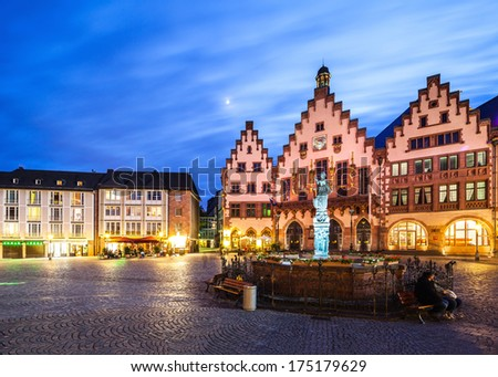Frankfurt city hall and statue of justice after sunset - stock photo