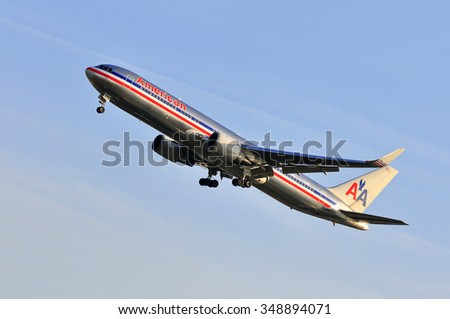 FRANKFURT,GERMANY-APR10:airplane of American above the Frankfurt airport on April 10,2015 in Frankfurt,Germany.American Airlines - American airline company owned by American Airlines Group in Texas. - stock photo