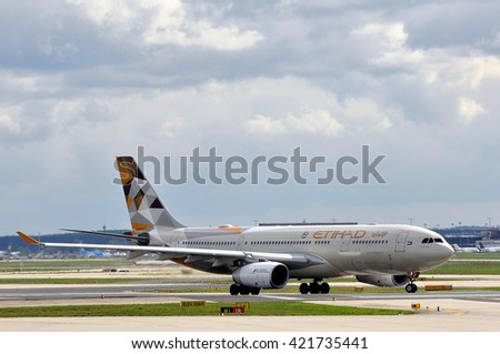 FRANKFURT,GERMANY-APRIL 07:Airbus A330 of Etihad Airways in the Frankfurt airport on April 07,2016 in Frankfurt,Germany.Etihad Airways- the second-largest airline, of the United Arab Emirates. - stock photo