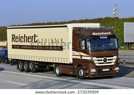 FRANKFURT,GERMANY-APRIL 10:Mercedes Benz truck on the highway on April 10,2015 in Frankfurt,Germany.MB is a German automobile manufacturer.