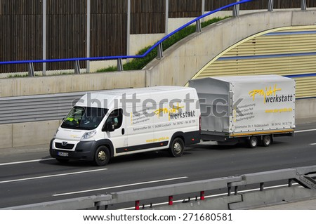 FRANKFURT,GERMANY-APRIL 16:Peugeot Peugeot with trailer on April 16,2015 in Frankfurt,Germany.Peugeot is a French car brand, part of PSA Peugeot Citron.