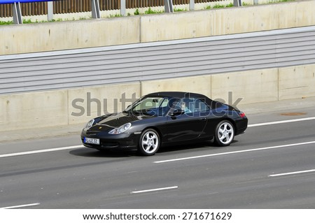 FRANKFURT,GERMANY-APRIL 16:porsche on the highway on April 16,2015 in Frankfurt,Germany.Porsche AG, is a German automobile manufacturer specializing in high-performance sports cars, SUVs and sedans. - stock photo