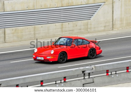 FRANKFURT,GERMANY-APRIL 16: porsche on the highway on April 16,2015 in Frankfurt,Germany.Porsche AG, is a German automobile manufacturer specializing in high-performance sports cars, SUVs and sedans. - stock photo