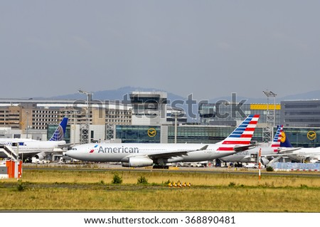 FRANKFURT,GERMANY-AUG10:airplane of American above the Frankfurt airport on August 10,2015 in Frankfurt,Germany.American Airlines - American airline company owned by American Airlines Group in Texas. - stock photo