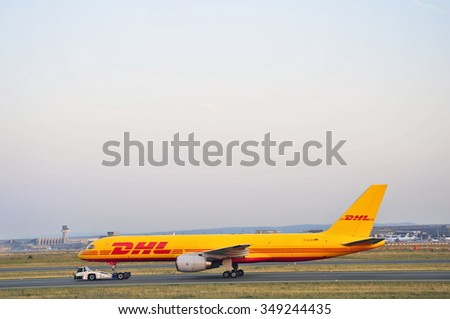 FRANKFURT,GERMANY-AUGUST 22:airplane of DHL Express in the Frankfurt airport on August 22,2015 in Frankfurt,Germany.DHL Express is a division of the German logistics company Deutsche Post DHL.