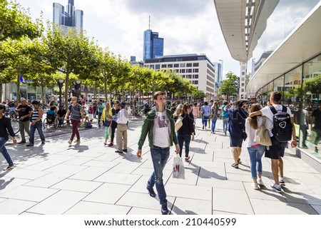 FRANKFURT, GERMANY - AUGUST 9, 2014: people walk along the Zeil in Midday  in Frankfurt, Germany. Since the 19th century it is of the most famous and busiest shopping streets in Germany. - stock photo