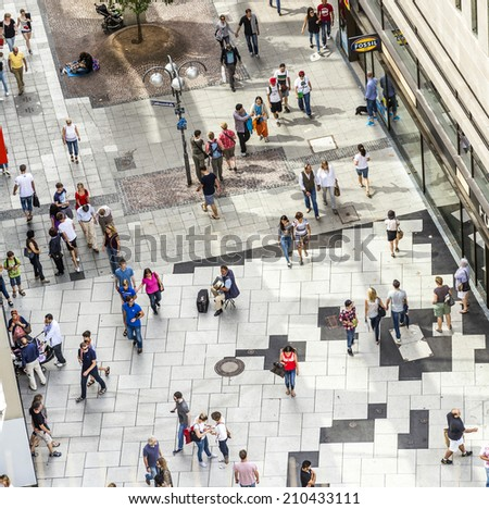 FRANKFURT, GERMANY - AUGUST 9, 2014: People walking along the Zeil street in Frankfurt, Germany. The place is one of the most famous and busiest shopping streets in Germany. - stock photo