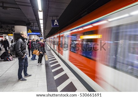 FRANKFURT, GERMANY - DEC 12, 2016: people wait for subway train to leave the station in Frankfurt. With 181,000 passengers per day, Hauptwache is the third busiest transit station in Frankfurt