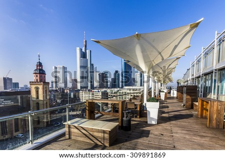 FRANKFURT, GERMANY - FEB 24, 2015: view from the panorama platform to the skyline in Frankfurt, Germany. The Kaufhof platform is open to public from 9.30 am to 9 pm and is free. - stock photo