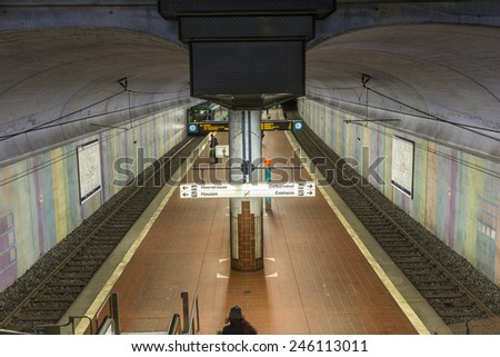 FRANKFURT, GERMANY - JAN 21, 2014: people wait at the metro station for the arriving train in Frankfurt, Germany. The Metro station was inaugurated 1978 after 8 years under construction. - stock photo