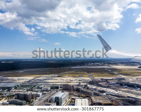 FRANKFURT, GERMANY - JULY 29, 2015: aerial of airport in Frankfurt Germany. The new runway opened in APR 2012 and causes a lot of polictical discussion because of heravy noise. - stock photo