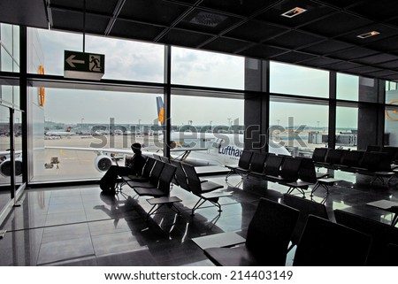 FRANKFURT, GERMANY-JULY 26, 2013: businesswoman at the airport. With 38 million passengers per year it is one of the most important airport in Europe. - stock photo